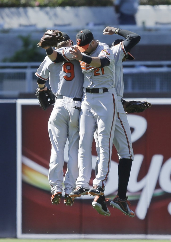 Orioles outfielders Nick Markakis, 21, Adam Jones, right, and Nate McLouth celebrate after a 10-3 victory over the San Diego Padres on Wednesday.