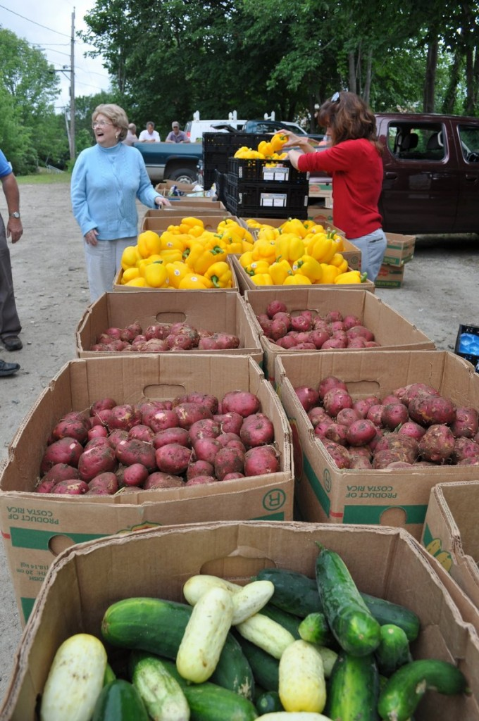 Food pantry volunteers from Lincoln County pick up produce last summer grown by farms participating in Mainers Feeding Mainers.