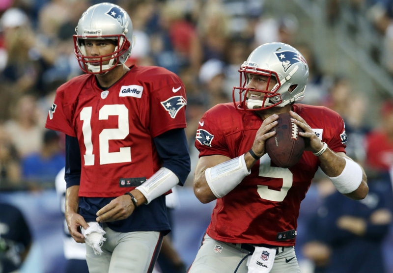 Tom Brady, left, recognizes that Tim Tebow is no threat with the New England Patriots, and is happy to give the former Heisman Trophy winner any help he can in learning the offense.