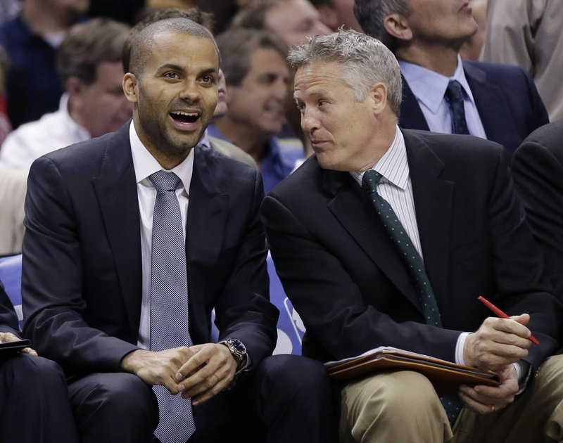 Tony Parker, left, flourished with the San Antonio Spurs after receiving help from Brett Brown, right.