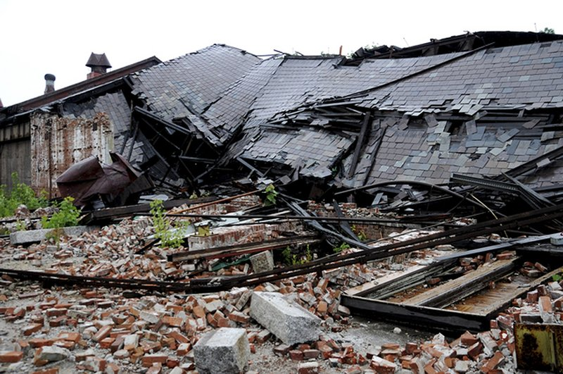 This Aug. 6 photo shows a section of slate roof that collapsed June 15 at the former Plume & Atwood brass mill complex in Thomaston, Conn. Efforts are under way to remove the debris, said a commercial real estate agent involved with the site.