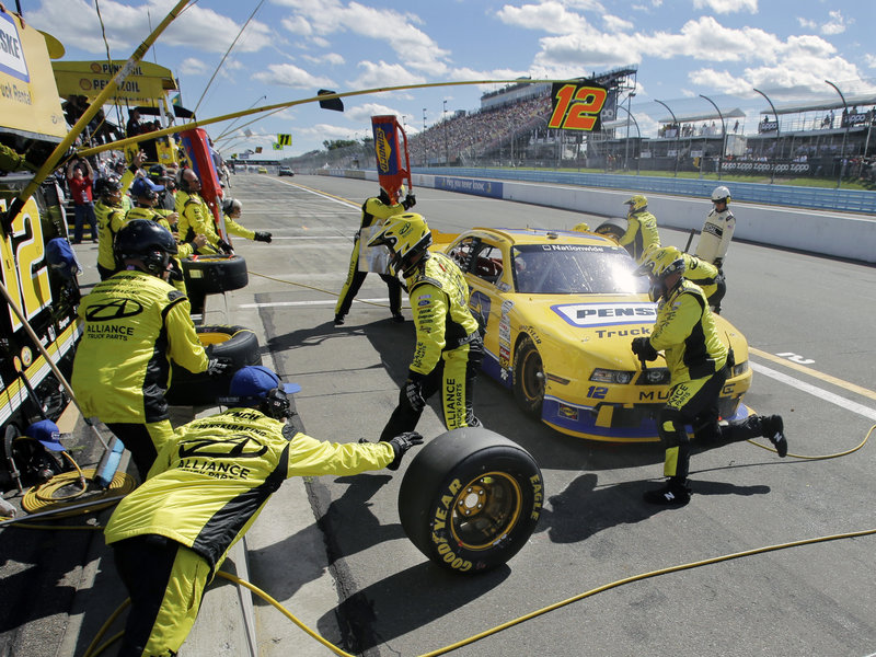 The crew for Sam Hornish Jr. gets busy as he makes a pit stop during the NASCAR Nationwide Series race at Watkins Glen, N.Y., on Saturday. Hornish came in second, losing by 1.4 seconds to reigning Sprint Cup champion Brad Keselowski.