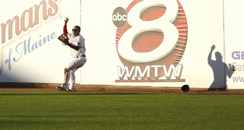 Johnson shows that, yes, he does have the ball after making the catch at the top of the right-field fence.