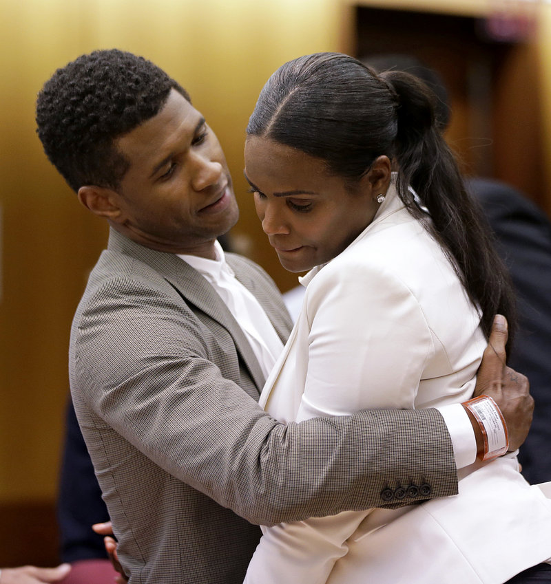 Usher embraces ex-wife Tameka Foster Raymond last week after a judge dismissed her request to have temporary custody of their two children.