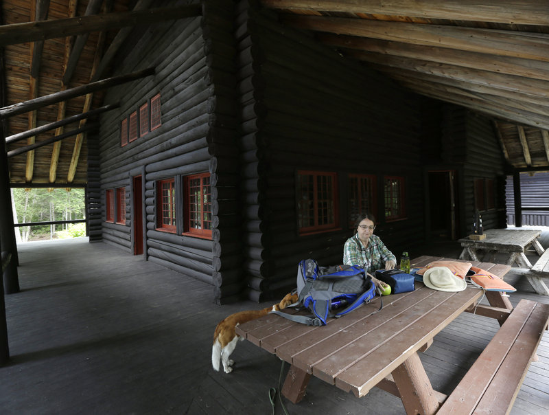Cynthia Taylor,of Watertown, Mass., has lunch on the porch at Camp Santanoni.