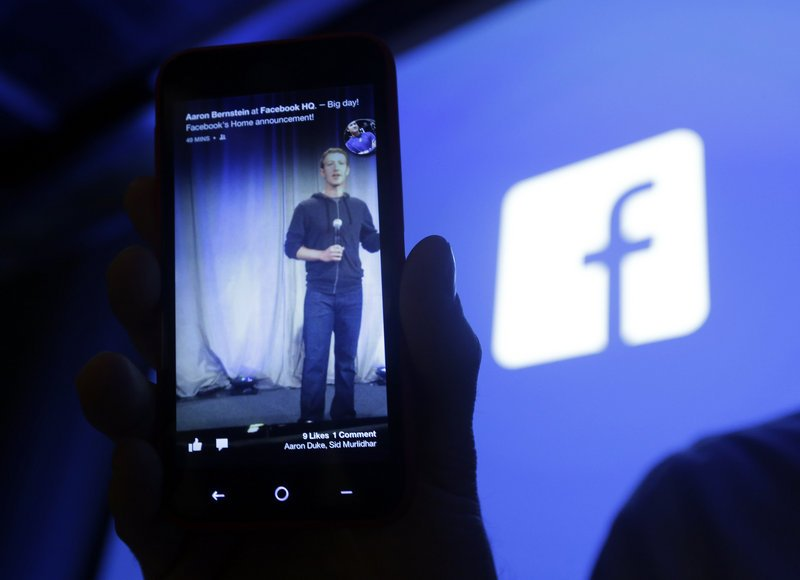 Facebook's mobile interface is displayed on a cellphone in April. Facebook plans to test a mobile payments service using payment data users have added to their Facebook account.