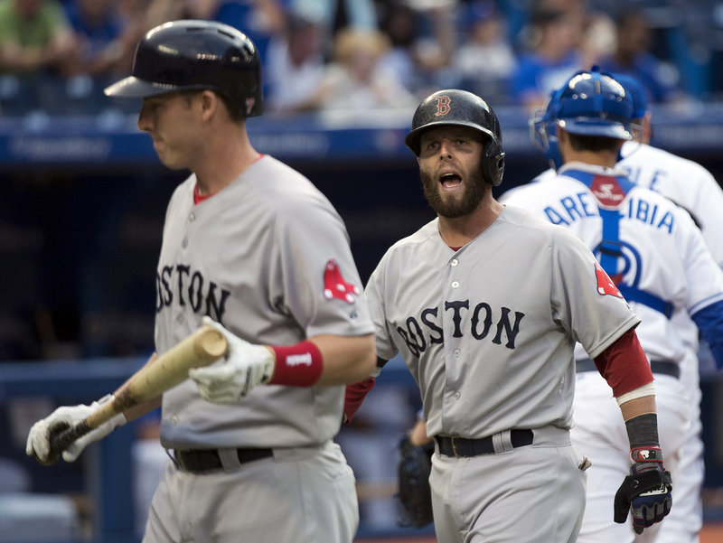 Dustin Pedroia, right, isn't happy with teammate Stephen Drew following a play at the plate Thursday night during Boston's 2-1 loss to the Toronto Blue Jays.