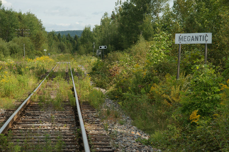 A sign alongside the Montreal, Maine & Atlantic Railway tells engineers they have arrived in Lac-Megantic, originally called Megantic, a town in Quebec about 22 miles from the Maine border.