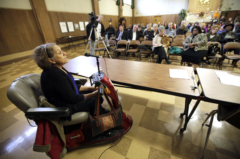 Shirin Cabraal, managing attorney of Disability Rights Wisconsin, addresses the crowd as state senators hold a public hearing into problems with LogistiCare at Washington Park Senior Center in Milwaukee Center on Oct. 18, 2012.