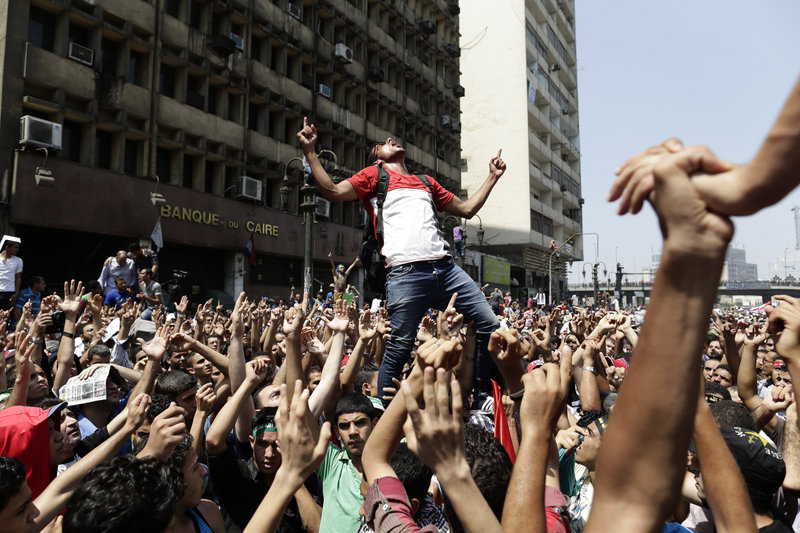 Supporters of ousted President Mohammed Morsi, above, chant slogans against Defense Minister Gen. Abdel-Fattah el-Sissi before clashing with Egyptian security forces in Ramses Square, in downtown Cairo, on Friday.