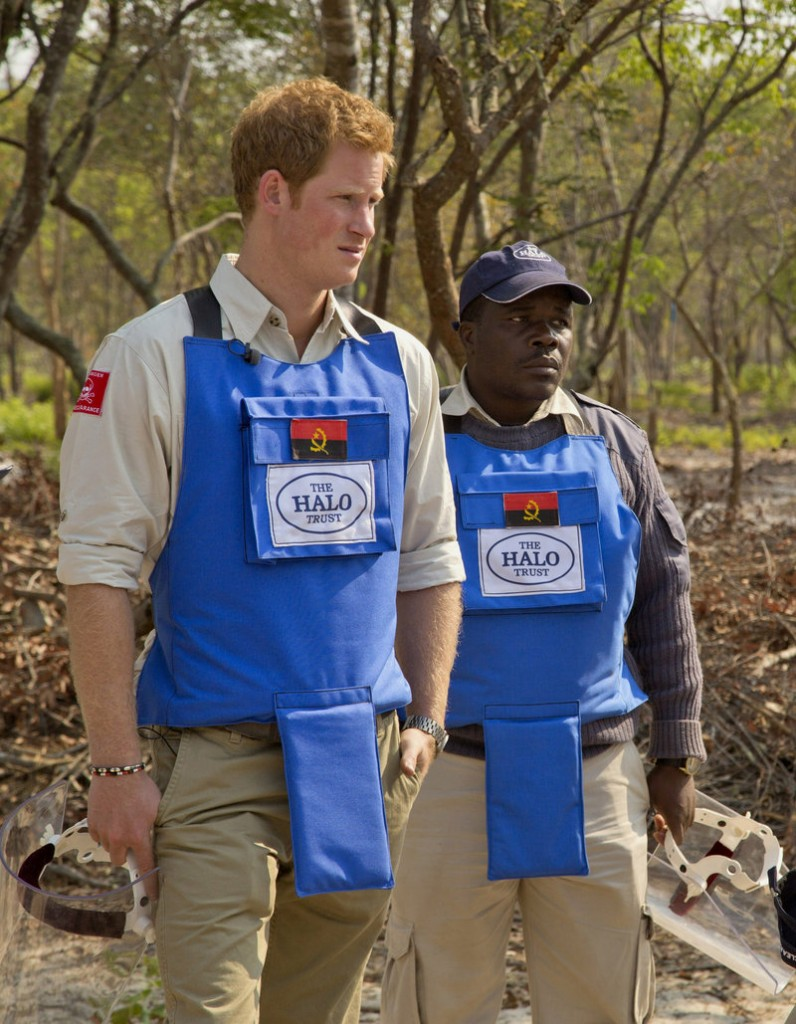 Prince Harry, left, tours a mine clearance site in Angola recently with HALO Trust provincial manager Tony Jose Antonio.