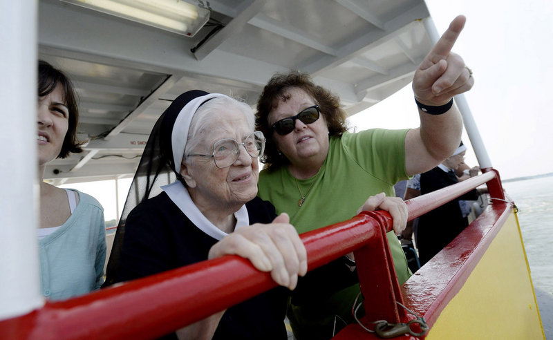 Sister Mary Louise Landry, who turned 102 on Sunday, enjoys a ride on a Casco Bay Lines Ferry on Tuesday, August 20, 2013. The ride was her birthday wish. She is with her caregivers from Frances Warde Convent in Portland. To the left is Angela Champagne and to the right is Mary Rich.