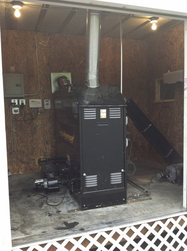 A wood pellet boiler in a HeatPod at the China Lake Conference Center is one of 11 Pelletco installations in Maine.