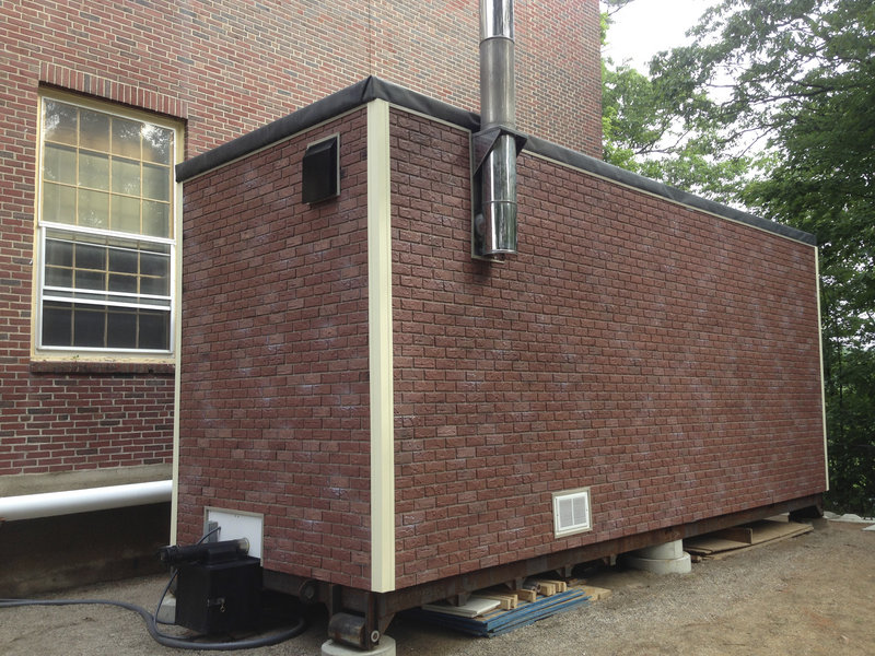 A Pelletco HeatPod containing a wood pellet-fed boiler is set up outside the Mildred Fox school in South Paris.