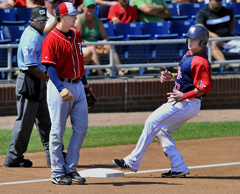 Christian Vazquez easily glides into third base on a triple Wednesday at Hadlock Field, where Portland beat Manchester behind the fine pitching of prospect Mickey Pena.