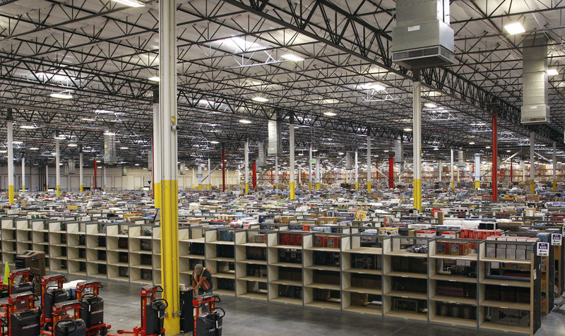 The Amazon.com warehouse in Goodyear, Ariz., is one of the retailer's older facilities. It has built at least 50 since 2010.