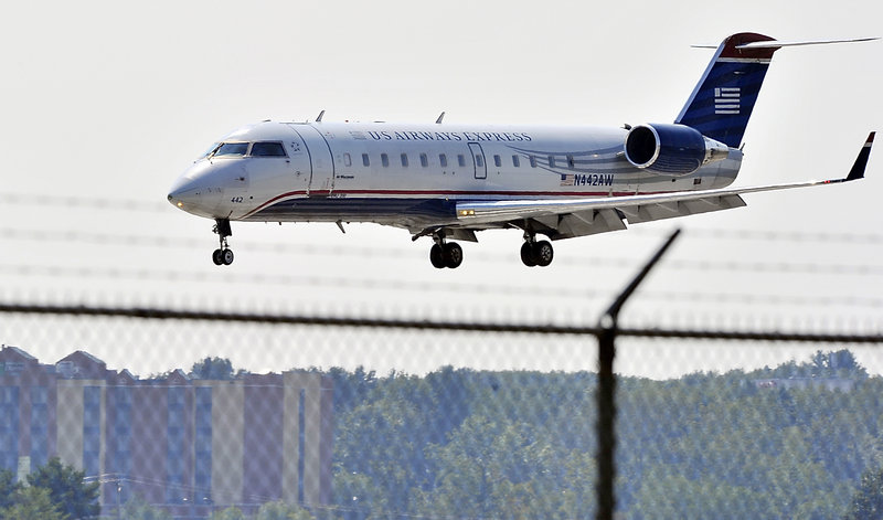 A US Airways Express prepares to land at the Portland International Jetport last week. US Airways and four other airlines – United, Delta, JetBlue and Southwest – fly out of Portland to 12 nonstop destinations.
