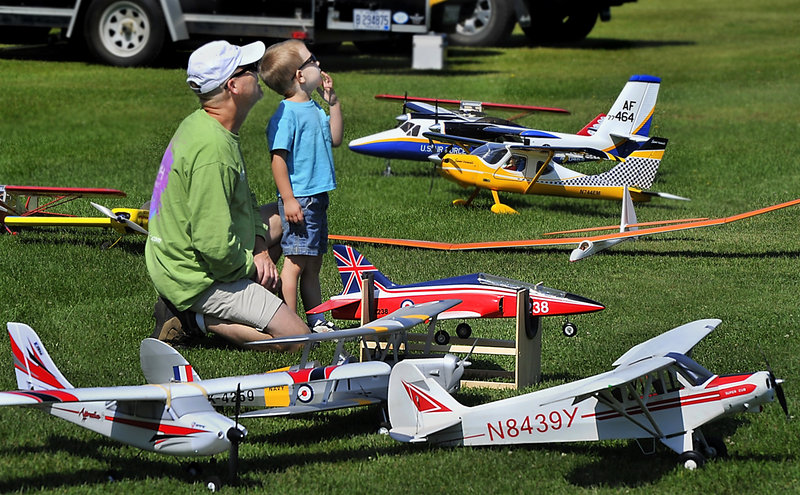 New Gloucester's Jim Washburn and his son enjoy last week's Fun Fly in New Gloucester, where model plane enthusiasts gathered from far and wide.