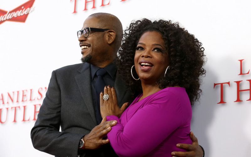 "Oprah Winfrey, right, shares a moment with Forest Whitaker at the premiere of ""Lee Daniels' The Butler."""