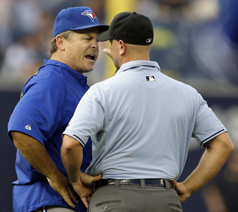 Toronto Blue Jays Manager John Gibbons goes cap-to-cap with first base umpire Scott Barry, who ejected him in the fifth inning of Toronto's 5-3 loss to the Yankees Thursday.