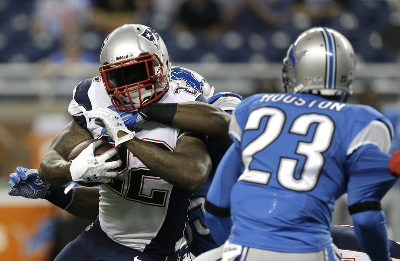 New England Patriots running back Stevan Ridley (22) is wrapped by the Detroit Lions defense in the first quarter in Detroit on Thursday.