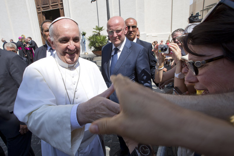 Pope Francis greets the faithful Aug. 15 as he leaves Castel Gandolfo, the pontiff's summer residence in the hills overlooking Rome. Francis has charmed the masses with his informal style, simplicity, sense of humor – and some personal calls.
