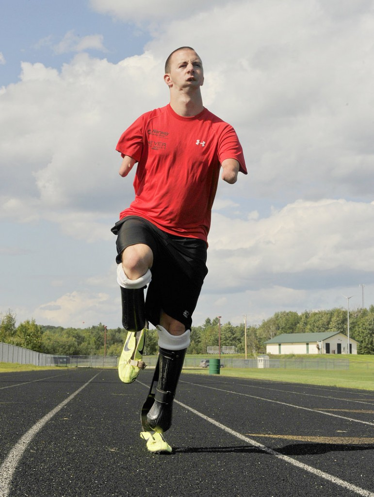 Josh Kennison gets in a little running on the Oxford Hills High School track earlier this month.