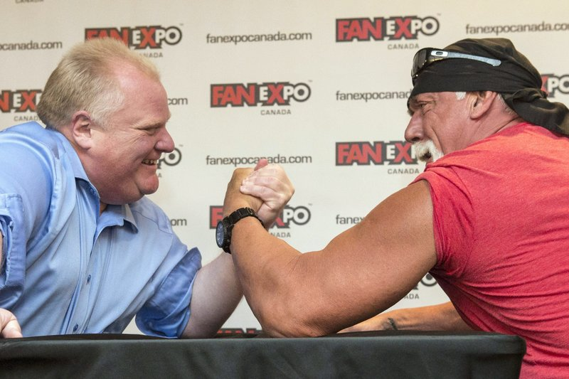 Toronto Mayor Rob Ford, left, takes on Hulk Hogan in an arm-wrestling match to promote Fan Expo in Toronto on Friday.