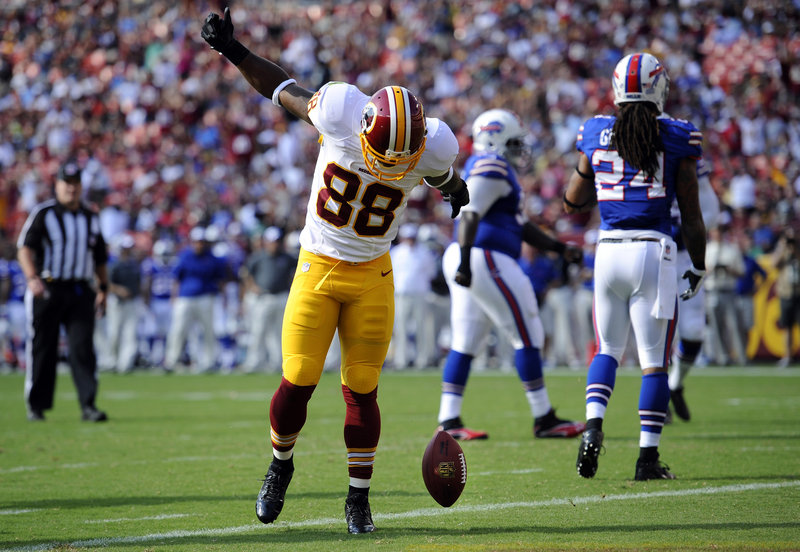 Redskins receiver Pierre Garcon celebrates after catching a touchdown pass Saturday, starting Washington on its way to a 30-7 win over the Bills.