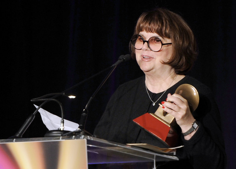 "Singer Linda Ronstadt, shown in 2011 receiving an achievement award, says she was ""totally shocked"" when she was diagnosed with Parkinson's disease."