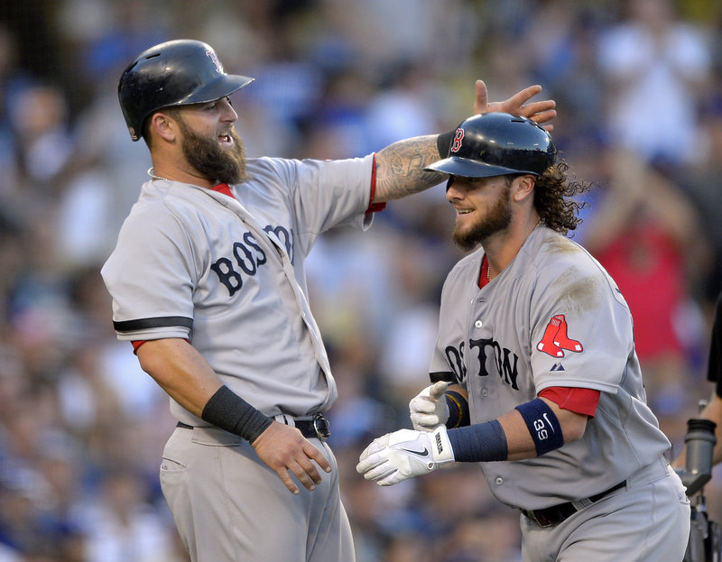 Mike Napoli, left, congratulates Jarrod Saltalamacchia after scoring on Saltalamacchia's home run in the sixth inning Sunday against the Los Angeles Dodgers. Napoli also homered and drove in three runs in an 8-1 victory.