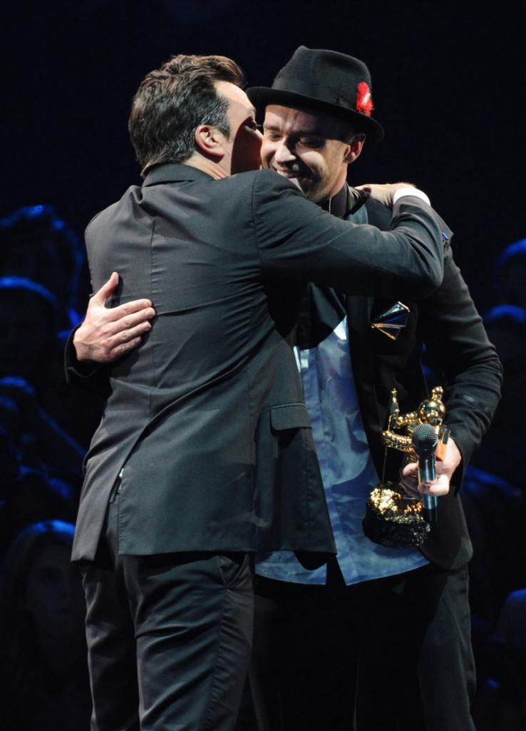 Justin Timberlake accepts the Michael Jackson Video Vanguard Award from Jimmy Fallon, left, at the MTV Video Music Awards Sunday night.