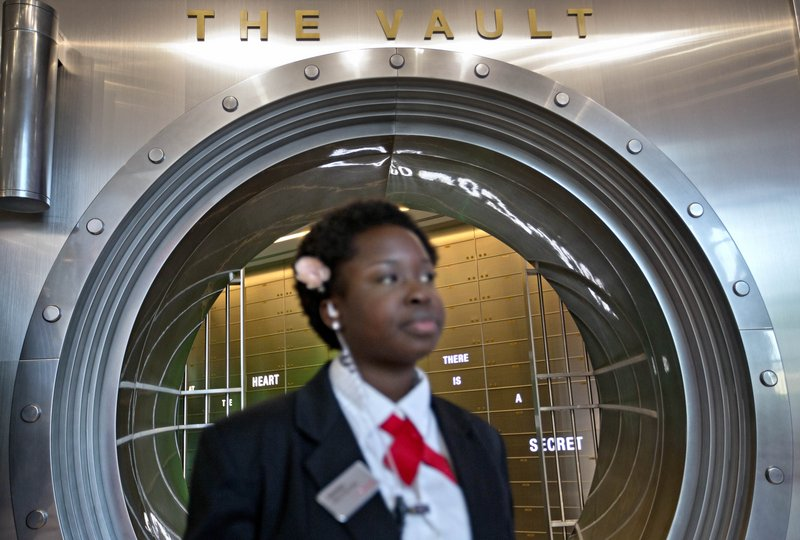 "Security officer Marilyn Buamah guards the soda ""secret recipe"" vault while waiting for a tour group at the World of Coca-Cola museum in Atlanta. The vault is bathed in red security lights and monitored by cameras."