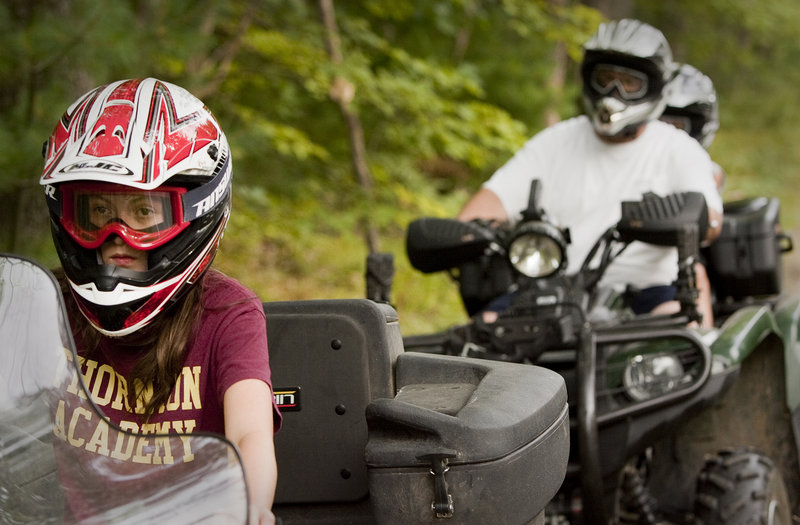 Twelve-year-old Alyssa Lajoie leads the way during a ATV trail ride with her Dad, Jim Lajoie, and his passenger, brother Ian, age 8, near their Dayton home on Monday, August 26, 2013. Alyssa took the training class at age 10 with her mother and was certified to ride on public trails.