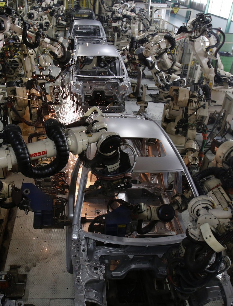 Robots work Tuesday on the Mazda6 car model assembly line at Mazda Motor Corp.'s plant in Hofu, Yamaguchi prefecture, in southwestern Japan.