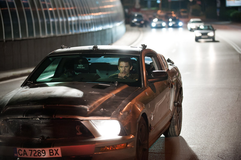 "Ethan Hawke stars as a disgraced racecar driver trying to save his wife (Rebecca Budig) from kidnappers in ""Getaway."""