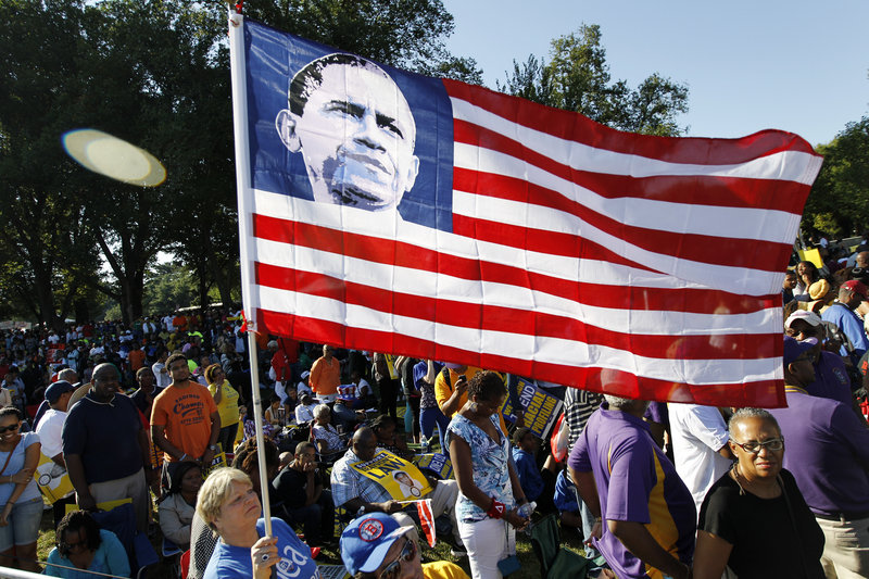 "Dorothy Meekins holds up a flag with a picture of President Obama as she attends the rally in Washington on Saturday commemorating the 50th anniversary of the 1963 March on Washington. In an interview Tuesday, Obama said he imagined King ""would be amazed in many ways about the progress we've made."""