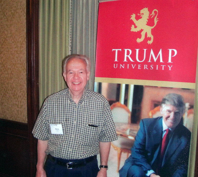 Bob Guillo poses with a cardboard cutout of billionaire Donald Trump in New York. Guillo paid $35,000 to attend a Trump University seminar but never got to meet Trump in person.