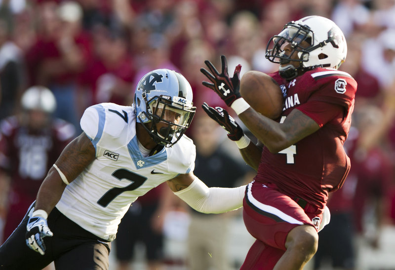 South Carolina wide receiver Shaq Roland catches a touchdown pass against North Carolina's Tim Scott during the Gamecocks' 27-10 win on Thursday in Columbia, S.C.