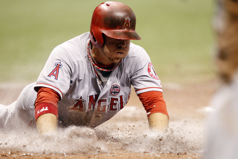 J.B. Shuck of the Los Angeles Angels slides home to score against Tampa Bay in the sixth inning of a 2-0 Angels win Thursday.