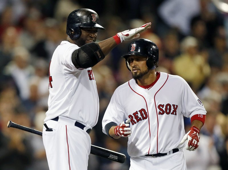 Boston's Shane Victorino gets a pat on the helmet from David Ortiz after Victorino's solo homer in the sixth inning of a 3-2 loss to the Orioles at Fenway Park on Thursday.