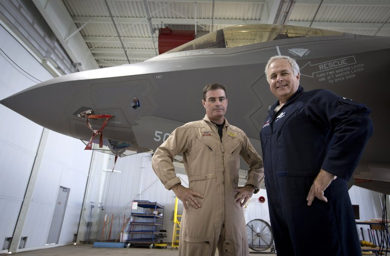 Lockheed Martin test pilots Bill Gigliotti, left, and Alan Norman appear on the line with an F-35A being made ready for delivery to Eglin Air Force Base in Florida earlier this month.