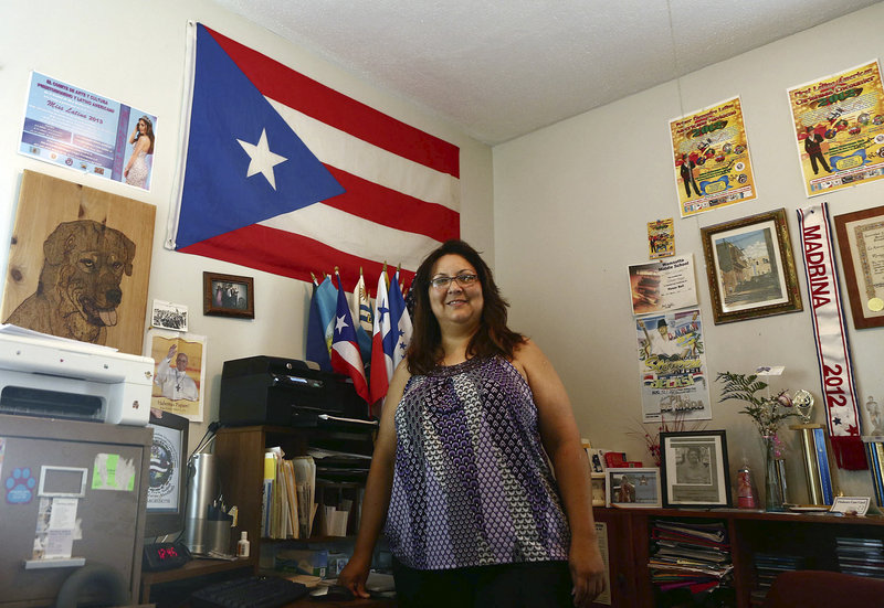 Mariangeli Vargas, founder of the recently-formed Puerto Rican and Latin American Art and Culture Committee, stands in the office at her New Bedford, Mass., home, in June.