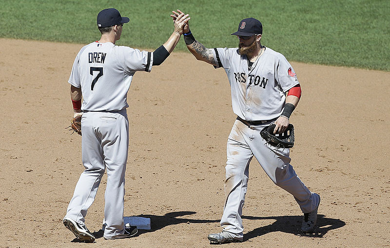 Shortstop Stephen Drew and left fielder Jonny Gomes celebrate after Wednesday's 12-1 victory over the San Francisco Giants.