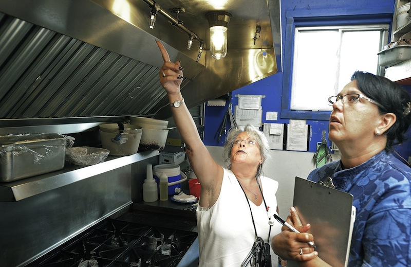 In this September 2012 file photo, Portland health inspector Michele Sturgeon goes through kitchen at El Rayo Taqueria. The city has inspected almost twice as many restaurants so far this year as it did in all of 2012, but fewer have failed inspections. The absence of Sturgeon – a strict, controversial inspector – has likely affected the numbers, as has the city's beefed up scrutiny and a falling non-compliance rate.