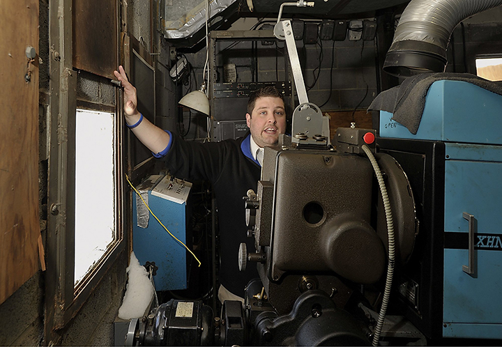 Ry Russell, who runs the Saco Drive-In, stands near one of the windows that the projector projects the movies through in this Tuesday, February 12, 2013. The Saco Drive-In won a national contest and will receive a new digital projection system, which will allow it to continue to operate next year.