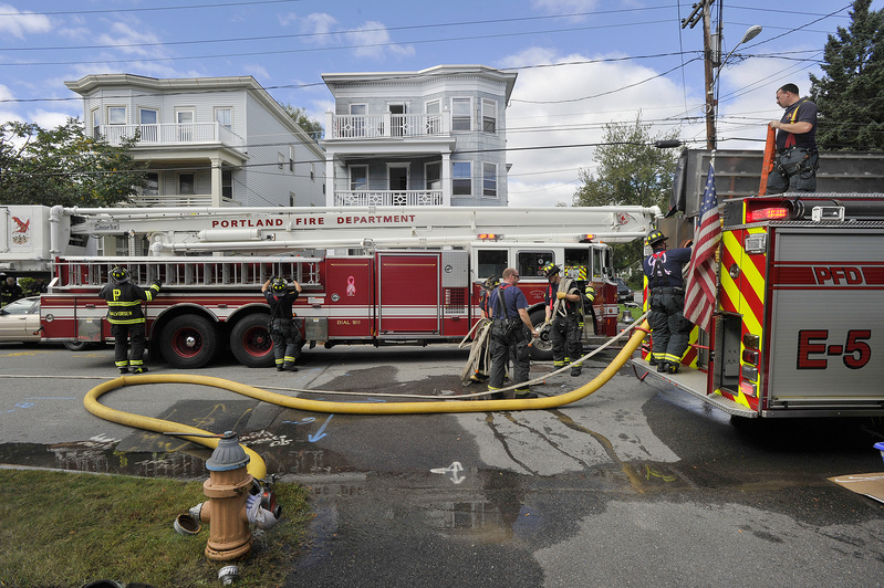 Portland firefighters quickly extinguished a fire in a three-story apartment building on Whitney Avenue in Portland on Thursday.