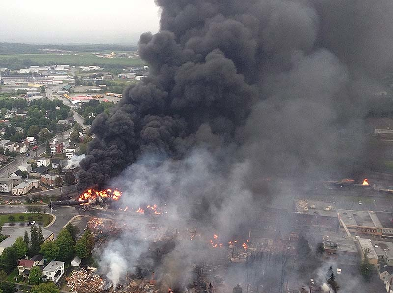 This July 6, 2013, photo shows the fire in Lac-Megantic, Quebec, following the derailment of a Maine, Montreal & Atlantic train transporting oil.