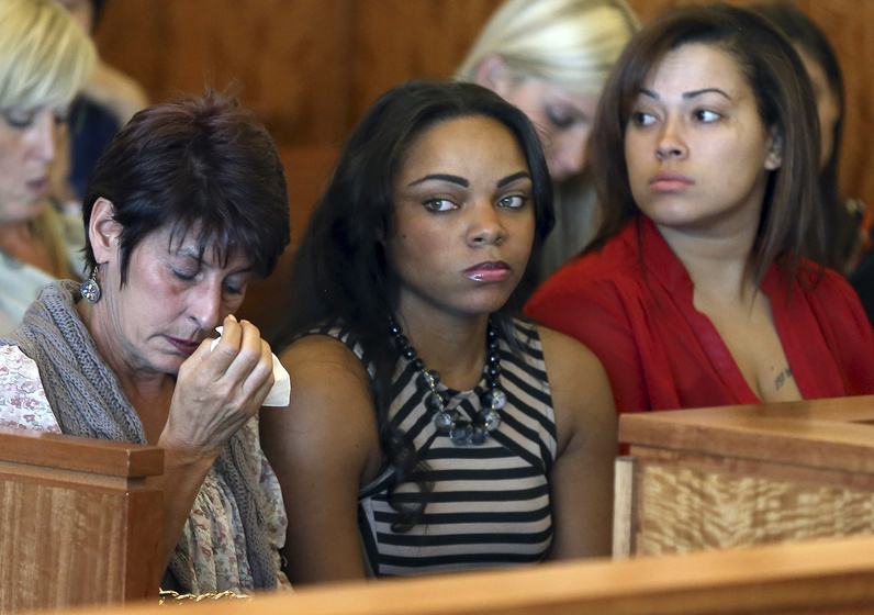 The girlfriend of former New England Patriots player Aaron Hernandez, Shayanna Jenkins, center, is shown at a court hearing for Hernandez earlier this month in Fall River, Mass.