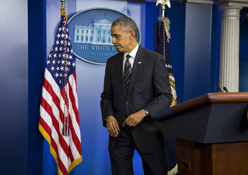 President Barack Obama leaves the podium after making a statement regarding the budget fight in Congress and foreign policy challenges on Friday at the White House in Washington.